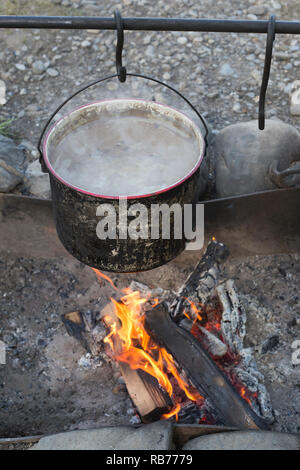 Water heating in pot over campfire Bar U Ranch National Historic Site roundup camp - Stock Image