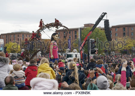 The Girl Giant passes the Albert Dock during the Giants Spectacular parade through Liverpool city centre UK - Stock Image