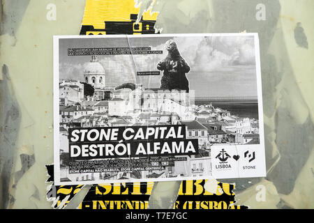 A poster protesting gentrification and property development in the traditional residental neighbourhood of Alfama Lisbon Portugal Europe  KATHY DEWITT - Stock Image