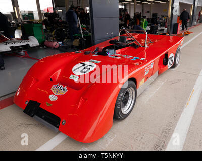 Mat and Mark Wrigley's  1971, Red, Chevron B19, in the International Pit Lane, during the 2019 Silverstone Classic Media Day - Stock Image