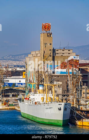 Freighter Hellas Liberty moored in port of Piraeus Athens Greece Europe - Stock Image