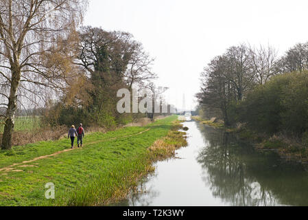 Young couple walking along the towpath of the Pocklington Canal, East Yorkshire, England UK - Stock Image