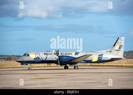 Swedish West Air Europe Freighter aircraft SE-MAI on lease, parked at Inverness Dalcross airports the Scottish Highlands. - Stock Image