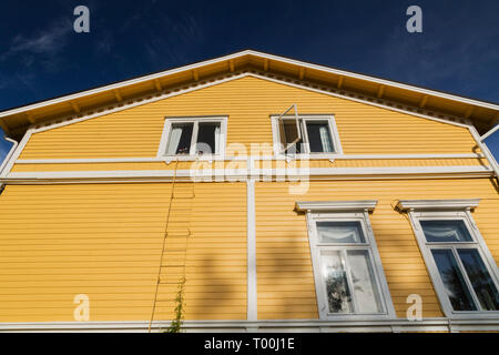 White windows on exterior side wall of a yellow two story house, Porvoo, Finland, Europe - Stock Image