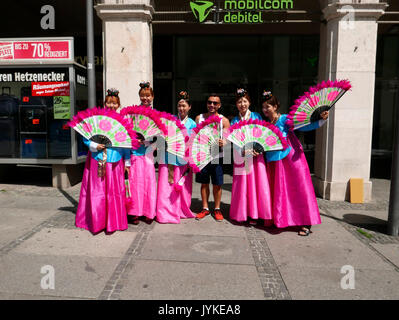 Germany Munich young ladies promoting Korean tourism at Karlsplatz - Stock Image