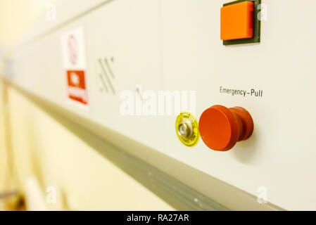 Bed head unit in a hospital ward showing an emergency red pull call bell and an electrostatic discharge point. - Stock Image