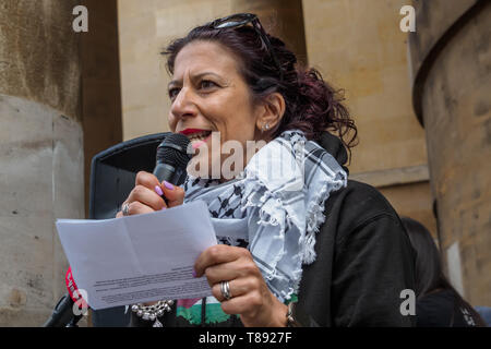 London, UK. 11th May 2019. A woman speaks before the march from the BBC to a rally in Whitehall a few days before Nakba day showing solidarity with the Palestinian people and opposing continued Israel violation of international law and human rights. The protest called for an end to Israeli oppression and the siege of Gaza and for a just peace that recognises Palestinian rights including the right of return. It urged everyone to boycott and divest from Israel and donate to medical aid for Palestine. Peter Marshall/Alamy Live News Credit: Peter Marshall/Alamy Live News - Stock Image