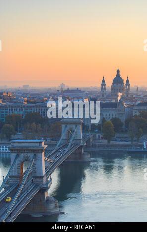 Chain Bridge (Szechenyi Bridge) and St Stephen‰Ûªs Basilica at sunrise, Budapest, Hungary - Stock Image