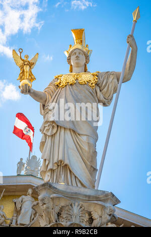 Vienna statue parliament, view of the statue sited on the Athena fountain at the entrance to the Parlament building in Vienna, Austria. - Stock Image