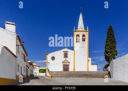 Igreja de Nossa Senhora da Conceicao Church. Mother Church of Crato with typical white washed walls and ochre or yellow color. Alto Alentejo, Portugal - Stock Image