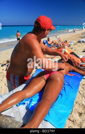 Cuba Playas del Este Massage on Playa Megano near Havana Photo CUBA1223 Copyright Christopher P Baker - Stock Image