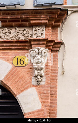 Mascaron grotesque on a building in Rue de Dalbade, Toulouse, Occitanie, France - Stock Image