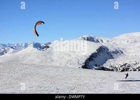 Kite skiing at Rittner Horn, Dolomite Alps - Stock Image