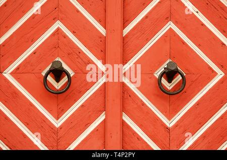 Historic door knockers at the old town hall gate, Hassfurt, Lower Franconia, Bavaria, Germany - Stock Image