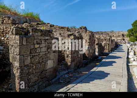 Old stone road with columns and ruins of the city of Side Turkey - Stock Image