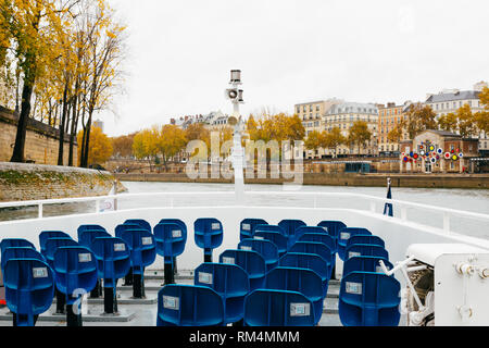 PARIS, FRANCE - NOVEMBER 11, 2018 - The Seine's navigation in bateau mouche in a rainy day - Stock Image