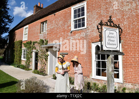 Jane Austen's House & Museum with 2 women in Regency costume of the period (1811-20), Chawton, near Alton, Hampshire, UK. - Stock Image