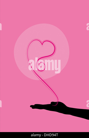Conceptual illustration of holding love in your hand - Stock Image