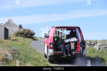 Ballot boxes are transported around Inishbofin in preparation for voting in the European Parliament elections. - Stock Image