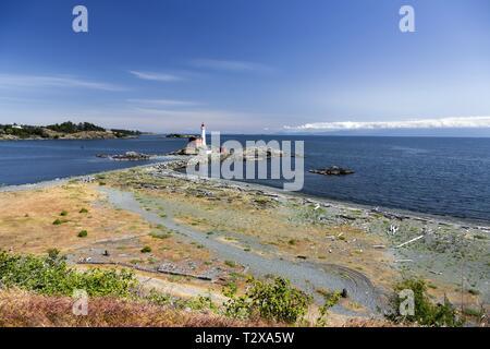 Fisgard Lighthouse, Springtime Wildflowers and Sweeping Pacific Ocean Panorama across Juan De Fuca Strait near Victoria BC Canada on Vancouver Island - Stock Image