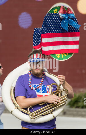 Anchorage, Alaska. 4th July, 2018. A tuba player decorated in patriotic colors marches in the annual Independence Day parade July 4, 2018 in Anchorage, Alaska. Credit: Planetpix/Alamy Live News - Stock Image