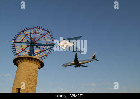 Windill and airplane Son Sant Joan airport of Palma de Mallorca Majorca Spain Balearic Islands Mediterranean - Stock Image
