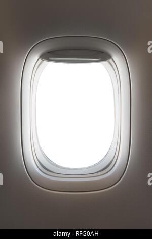 looking through a big jet passenger plane window, white space - Stock Image