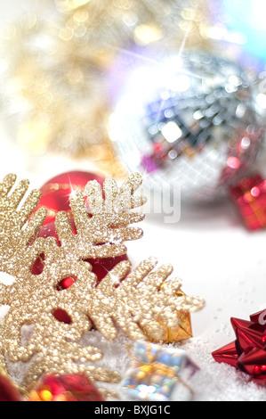 Christmas decoration with disco ball and snowflake - Stock Image