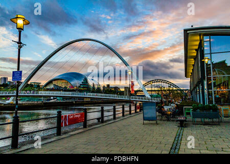 View of the Tyne River from outside Pitcher & Piano bar, looking towards the Millennium Bridge, Tyne Bridge and the Sage at sunset. Newcastle, UK. - Stock Image