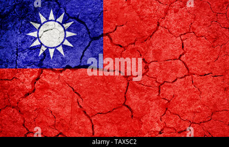 Taiwan flag, Republic of China flag, on dry earth ground texture background - Stock Image