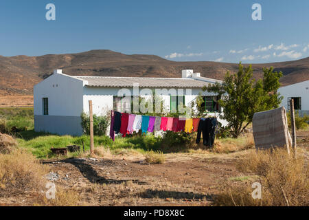 Washing drying outside a house in the Biedouw Valley in the Cederberg Mountains in South Africa. - Stock Image