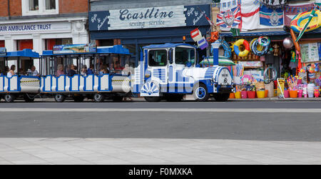 The 'land train' tourist ride in Exmouth, stopping outside a beach shop. - Stock Image