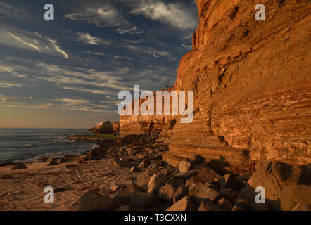 Waves from Pacific Ocean crashing on rocky shoreline along famous Sunset Cliffs, Point Loma, San Diego, CA, USA - Stock Image