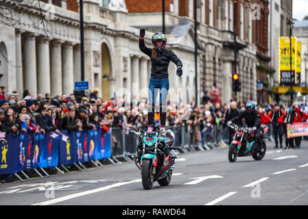 Moto Stunts International motorbike display team at London New Year's Day Parade. Cassandra Ryder of Stunted Reality motorcycle stunt in Whitehall - Stock Image