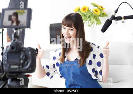 Female Vlogger Recording Broadcast At Home - Stock Image