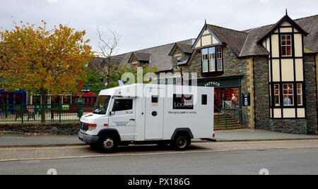 Loomis security cash collection van,Ambleside,Lake District,Cumbria,England,UK - Stock Image