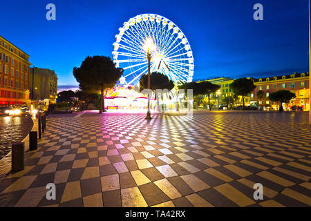 Nice giant ferris wheel and Massena square evening view, Alpes-Maritimes region of France - Stock Image
