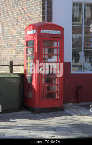 defibrillator in an ols telephone box in steyning west sussex - Stock Image