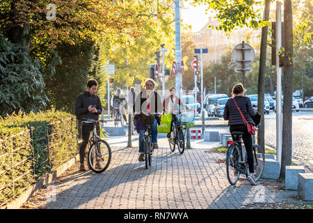 Strasbourg, Alsace, France, people bicycling on pavement, late afternoon light, - Stock Image