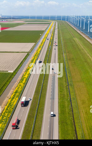 Aerial view of road and wind turbines, North Holland, Netherlands - Stock Image