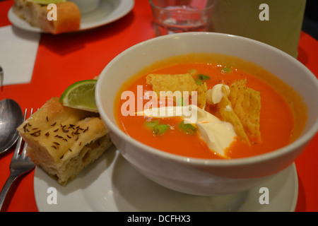 Food - Gazpacho, a tomato soup, with corn chips and creme fraiche, on the menu in a bookstore/cafe in Notting Hill, - Stock Image