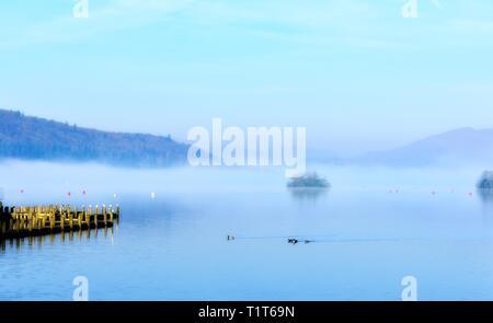 Mist morning on Lake Windermere, Bowness on  Windermere,Lake District,Cumbria,England,UK - Stock Image