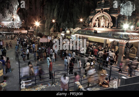 Hindu devotees worship inside Batu Caves temple during Thaipusam festival in Selangor, Malaysia - Stock Image