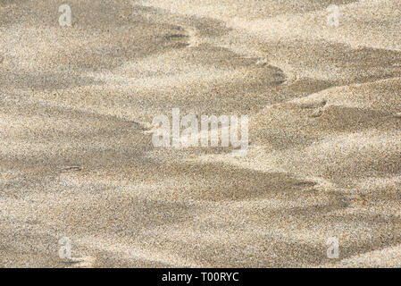Texture of yellow sand on the beach - Stock Image