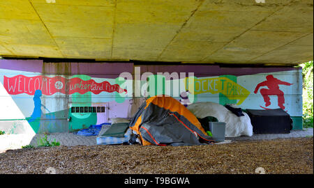 Rough sleeping, homeless under a bridge with tent and mattress - Stock Image