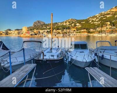 Early morning with boats in the marina and fishing boats  in the port behind, Javea / Xabia, Costa Blanca , Spain - Stock Image