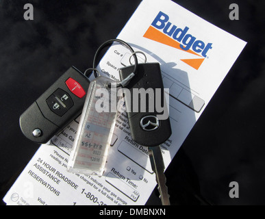 Budget Rent a Car contract and keys. The license number was digitally altered. - Stock Image