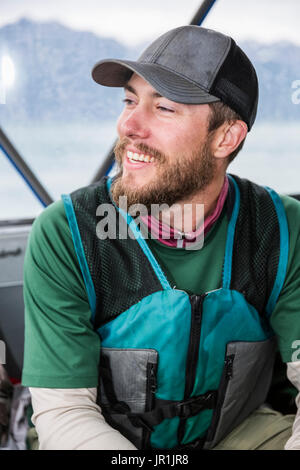 Tourist On Boat Wearing A Life Vest, Seward, Southcentral Alaska, USA - Stock Image