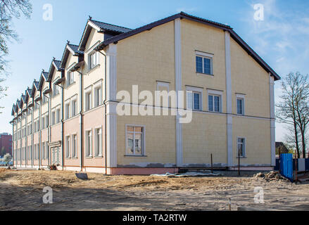 construction of a new office building on sunny summer day - Stock Image