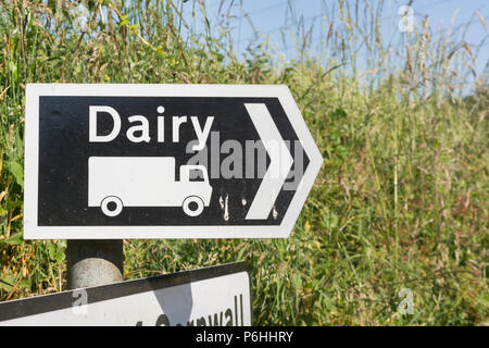 Sign to a dairy on a rural country road. Metaphor for the Dairy industry. - Stock Image